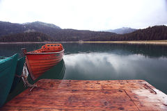 Wooden boat on a mooring mountain Royalty Free Stock Image