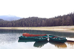 Wooden boat on a mooring mountain Stock Photography