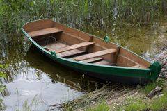 Wooden boat near the coast Stock Photo
