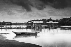 Wooden boat near jetty Stock Image