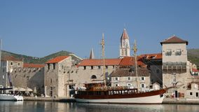 Wooden boat near the old town of Trogir stock footage