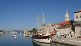 Wooden boat near the old town of Trogir. Croatia stock footage