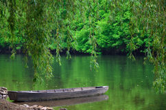 Wooden boat near the shore of the lake Stock Photography