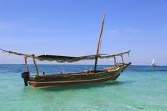Wooden boat in ocean stock images