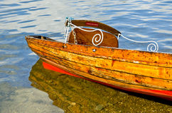 Wooden boat. Old rowing boat on the water Royalty Free Stock Images