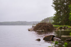 Wooden boat pier on lake. Palvaanjarven Campsite, Lappeenranta, Royalty Free Stock Photography