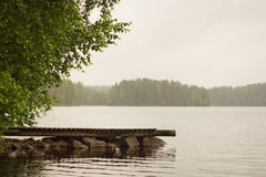 Wooden boat pier on lake. Palvaanjarven Campsite, Lappeenranta, Royalty Free Stock Images
