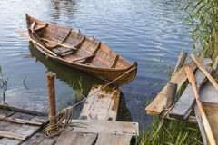 Wooden boat at the pier Royalty Free Stock Image