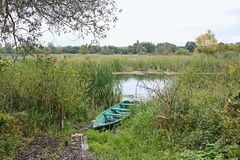 Wooden boat on the pond Stock Photo