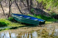 Wooden Boat and pond in a sanctuary Stock Photo