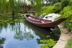 Wooden boat in pond Stock Photo
