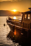 Wooden Boat Ready to sail into the Sunset Stock Photo