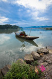Wooden boat on river Royalty Free Stock Image