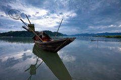 Wooden boat on river stock images