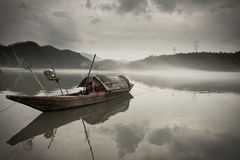 Wooden boat on river Royalty Free Stock Photos