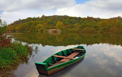 Wooden boat on river Stock Photography