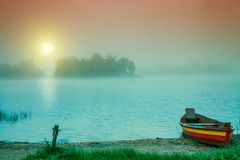 Wooden boat on the river bank Stock Photography