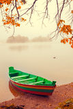 Wooden boat on the river bank Stock Image
