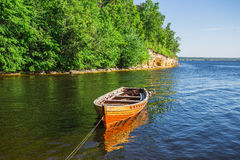 Wooden boat on the river bank Stock Photo