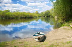 Wooden boat on the river bank Royalty Free Stock Photos