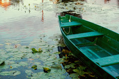 Wooden boat in a river Royalty Free Stock Photos