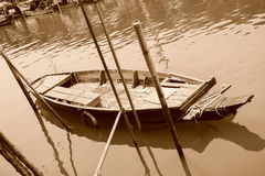 Wooden boat on the river with sepia tone. Stock Images