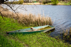 Wooden boat on river shore Stock Images