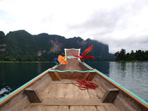 Wooden boat on river Stock Photos
