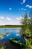 A wooden boat by the river Royalty Free Stock Photography