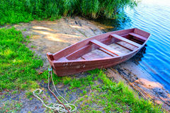 Wooden boat at the riverbank Royalty Free Stock Images