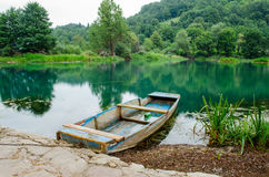 Wooden boat at the riverbank Stock Image