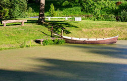 Wooden boat at the riverbank Royalty Free Stock Photography