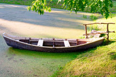 Wooden boat at the riverbank Stock Photo