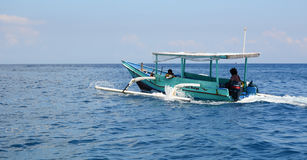 A wooden boat running on blue sea in Gili Meno, Indonesia Stock Images