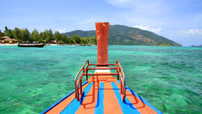 Wooden boat sailing on crystal sea to Lipe island Royalty Free Stock Photos