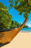 Wooden boat on sandy shore of exotic beach Stock Photography
