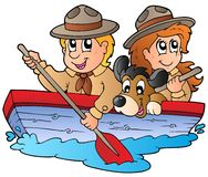 Wooden boat with scout boy and girl Royalty Free Stock Photos