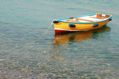 Wooden boat in the sea. In Cornwall UK Stock Photo