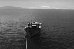 Wooden boat on the sea in black and white. South China Sea, Vietnam, Stock Photography