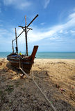 Wooden boat and sea. In sun light Royalty Free Stock Images