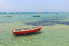 Wooden boat in shallow water Stock Image