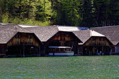 Wooden boat sheds with electric boat Stock Image