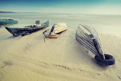 Wooden boat on the shore. Old wooden Boat on the beach during sunrise Royalty Free Stock Photography
