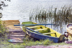 Wooden boat  on the shore Stock Photos