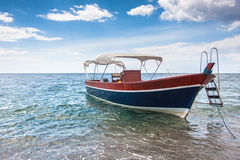 Wooden boat on the sicilian beach, Italy Royalty Free Stock Photography