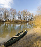 Wooden boat on spring river. Royalty Free Stock Photos