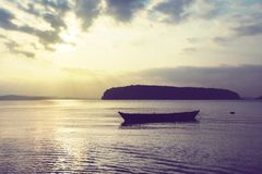 Wooden boat in a stormy sea stock photography