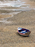 Wooden boat stranded due low tide Royalty Free Stock Images