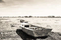Wooden boat stranded. On sand in Brittany stock photos