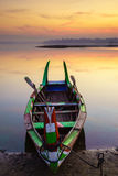 Wooden boat at sunrise, Mandalay, Myanmar Royalty Free Stock Photos